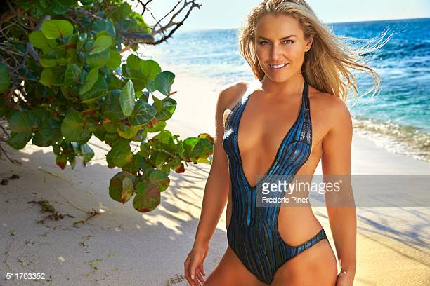 Skier Lindsey Vonn poses for the 2016 Sports Illustrated swimsuit issue on November 30 2015 in Saint Vincent and The Grenadines Body painting by...