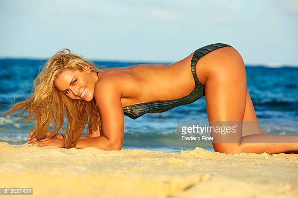 Skier Lindsey Vonn poses for the 2016 Sports Illustrated swimsuit issue on November 18 2015 in Saint Vincent and The Grenadines Body painting by...