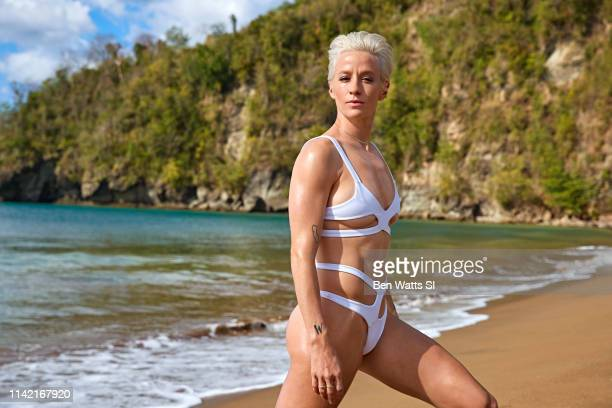 Swimsuit Issue 2019 Soccer player Megan Rapinoe poses for the 2019 Sports Illustrated swimsuit issue on March 13 2019 in Saint Lucia PUBLISHED IMAGE...