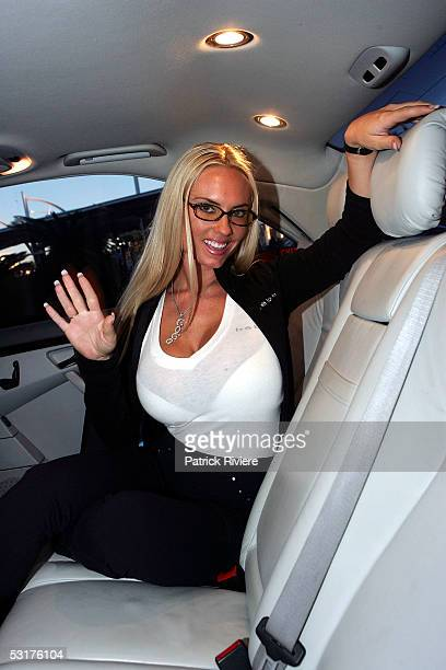 Swimsuit model Coco waves inside her limousine after arriving at Sydney Airport on July 1 2005 in Sydney Australia Coco joins her husband rapper IceT...