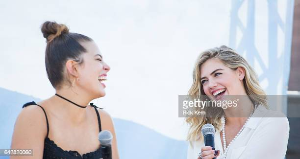 Swimsuit models Ashley Graham and Kate Upton laugh during a panel at the VIBES by Sports Illustrated Swimsuit 2017 launch festival on February 18...