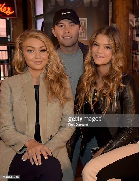 Swimsuit models Gigi Hadid and Nina Agdal are joined by Singer/Songwriter Scotty McCreery during SI NOW at Tootsie's Orchid Lounge on February 12...