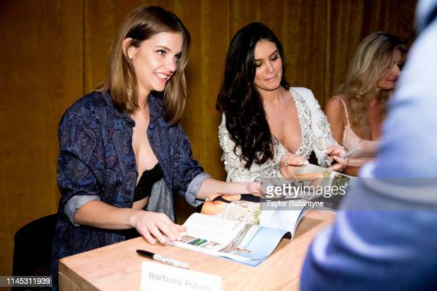 SI Launch Week Barbara Palvin and Anne de Paula signing autographs for fans during launch week event at Ice Palace Miami FL CREDIT Taylor Ballantyne