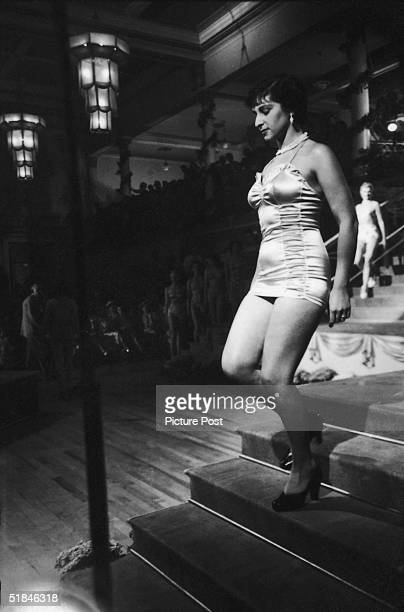 A swimsuitclad young woman on stage for a beauty parade in the film 'Lady Godiva Rides Again' a satirical comedy based on contestants in a beauty...