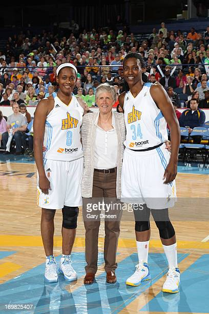 Swin Cash and Sylvia Fowles of the Chicago Sky pose for a photo with Carol Callan USA Basketball Women's National Team Director during a ceremony...
