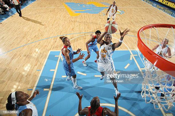 Swin Cash of the Chicago Sky goes to the basket past Erika de Souza and Angel McCoughtry of the Atlanta Dream on August 17 2012 at the Allstate Arena...