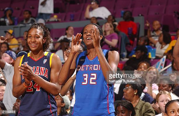 Swin Cash of the Detroit Shock and Tamika Catchings of the Indiana Fever cheer other basketball players during the 2003 WNBA AllStar Skills...