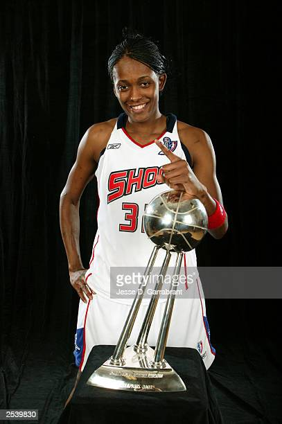 Swin Cash of the Detroit Shock celebrates with the 2003 WNBA Championship trophy after the Shock defeated the Los Angeles Sparks in Game three of the...