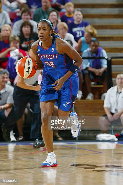 Swin Cash of the Detroit Shock drives against the Sacramento Monarchs during the game at Arco Arena on June 19 2004 in Sacramento California The...