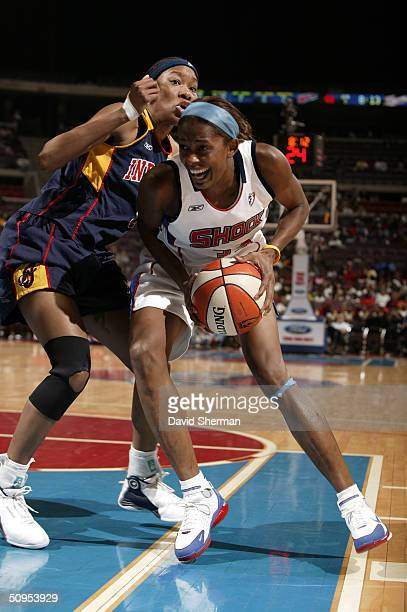 Swin Cash of the Detroit Shock drives to the basket against Deanna Jackson of the Indiana Fever on June 12 2004 at the Palace of Auburn Hills in...