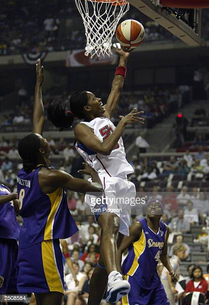 Swin Cash of the Detroit Shock lays the ball past DeLisha Milton of the Los Angeles Sparks during game two of the 2003 WNBA Finals at The Palace of...
