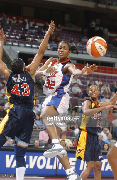 Swin Cash of the Detroit Shock passes the ball during the game against the Indiana Fever at the Palace of Auburn Hills in Auburn Hills Michigan on...