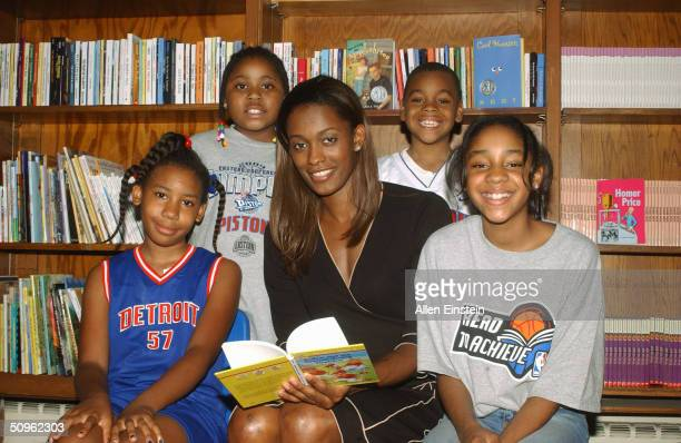 Swin Cash of the Detroit Shock reads to students at the NBA and Detroit Pistons Reading and Learning Center opening June 15 2004 at the Cornerstone...