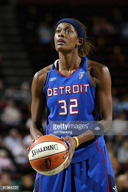 Swin Cash of the Detroit Shock shoots a free throw against the Seattle Storm during the game at Key Arena on September 8 2004 in Seattle Washington...