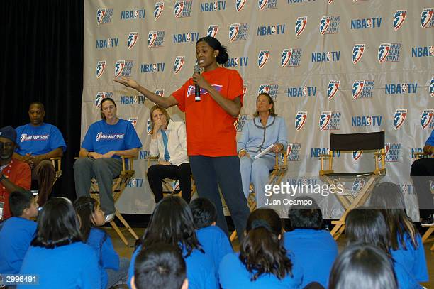 Swin Cash of the Detroit Shock speaks to children as part of the WNBA Mind Body and Spirit program on February11 2004 at 10th Street Elementary...