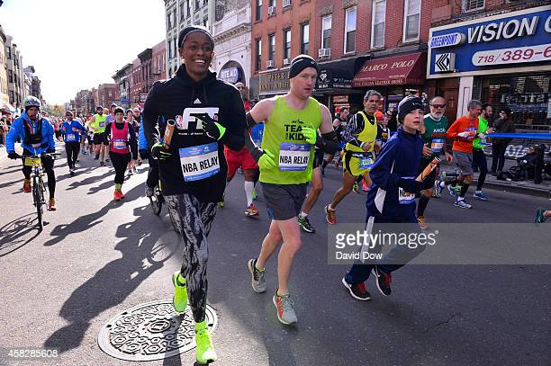 Swin Cash of the New York Liberty runs her leg in the 2014 NBA AllStar Relay during the TCS NYC Marathon on November 2 2014 in New York City NOTE TO...