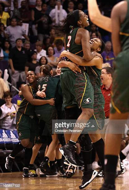 Swin Cash of the Seattle Storm celebrates with Tanisha Wright after defeating the Phoenix Mercury in Game Two of the Western Conference Finals during...