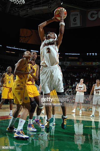 Swin Cash of the Seattle Storm goes to the basket against Tina Thopson and Lisa Leslie of the Los Angeles Sparks during Game Three of the WNBA...