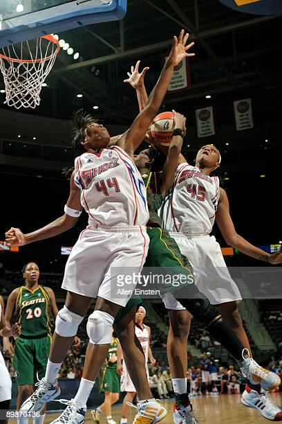 Swin Cash of the Seattle Storm is doubled by Taj McWilliams and Kara Braxton of the Detroit Shock at The Palace of Auburn Hills August 18 2009 in...