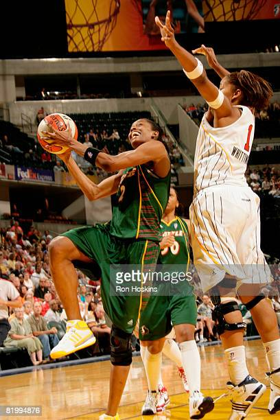Swin Cash of the Seattle Storm looks to score on Khadijah Whittington of the Indiana Fever at Conseco Fieldhouse on July 18 2008 in Indianapolis...