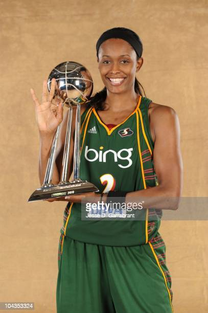 Swin Cash of the Seattle Storm poses with the WNBA Championship Trophy after defeating the Atlanta Dream in Game Three of the 2010 WNBA Finals on...