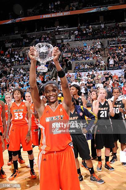 Swin Cash of the Western Conference AllStars holds up the MVP Trophy against the Eastern Conference AllStars during the 2011 WNBA AllStar Game at ATT...