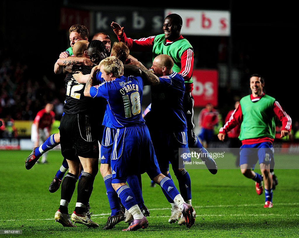 Swindon players mob goalkeeper Phil Smith of Swindon after his penalty save during the Coca-Cola League One Playoff Semi Final 2nd Leg between Charlton Athletic and Swindon Town at The Valley on May 17, 2010 in London, England.