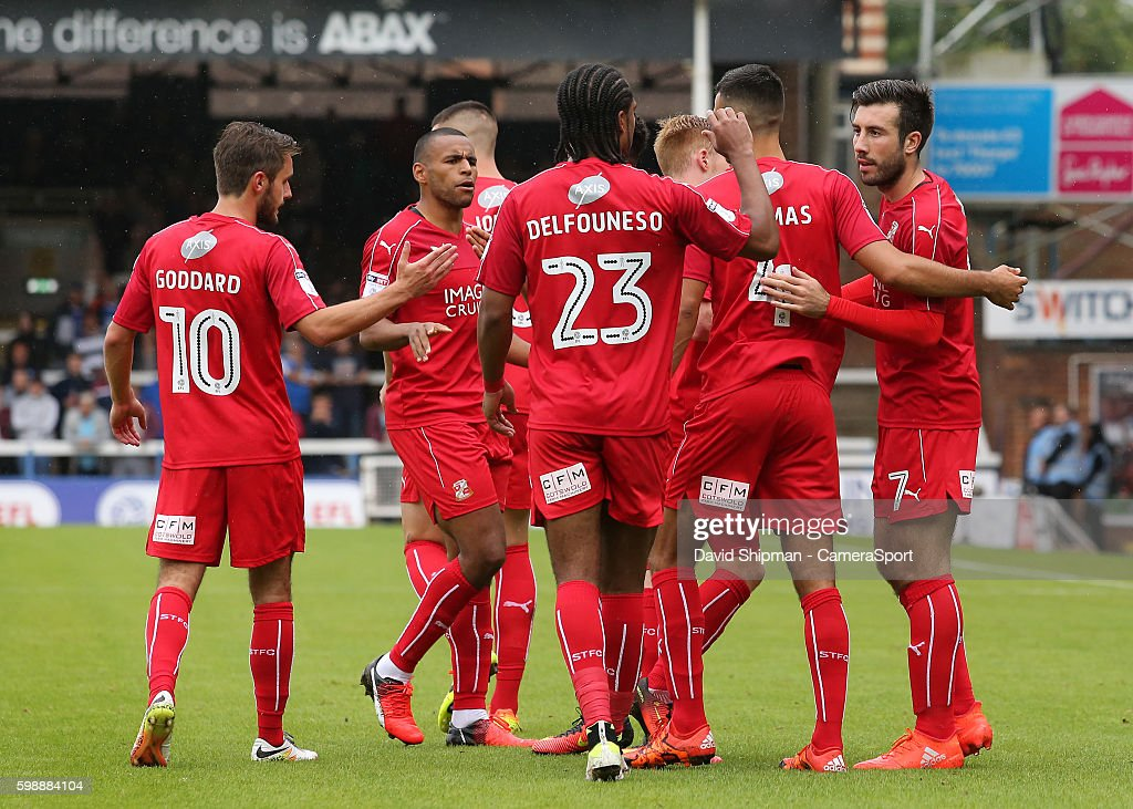 Swindon Town celebrate after Michael Doughty draws them level from the penalty spot (1-1) during the Sky Bet League One match between Peterborough United and Swindon Town at ABAX Stadium on September 3, 2016 in Peterborough, England.