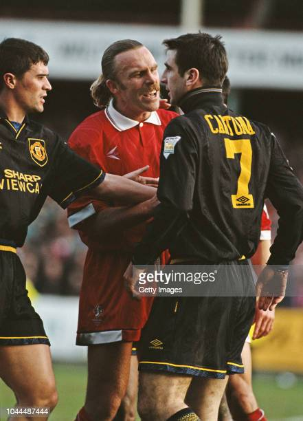Swindon Town defender Brian 'Killer' Kilcline has words with United player Eric Cantona who is sent off for violent conduct as Roy Keane attempts to...