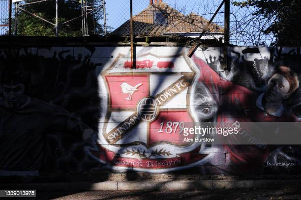 Swindon Town FC mural is seen on a wall outside the stadium prior to the Papa John's Trophy match between Swindon Town and Arsenal U21 at County...
