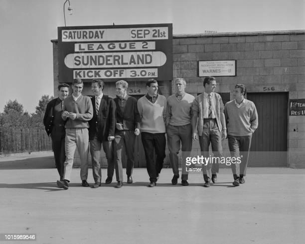 Swindon Town FC players Don Rogers Roger Smart John Smith John Trollope Mike Turner Ken McPherson Owen Dawson Ernie Hunt outside County Ground...