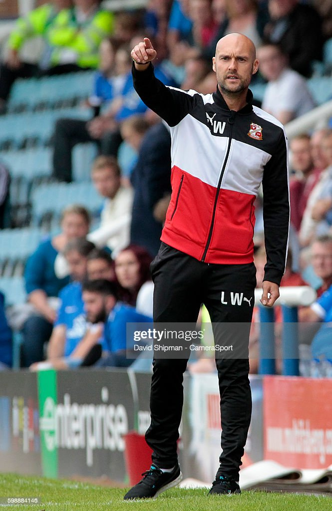 Swindon Town manager Luke Williams shouts instructions to his team from the dug-out during the Sky Bet League One match between Peterborough United and Swindon Town at ABAX Stadium on September 3, 2016 in Peterborough, England.