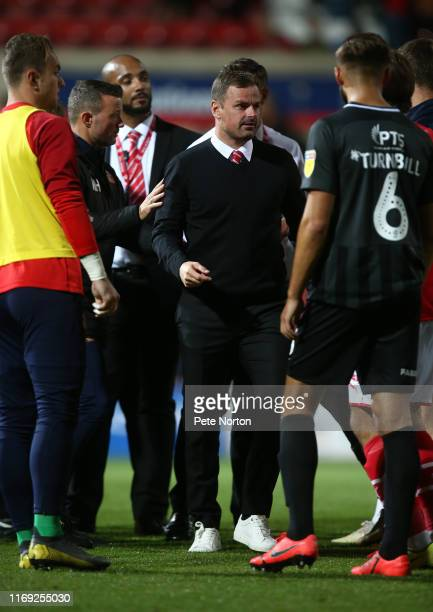 Swindon Town manager Richie Wellens is lead away after remonstraiting with referee Craig Hicks at the final whistle during the Sky Bet League Two...
