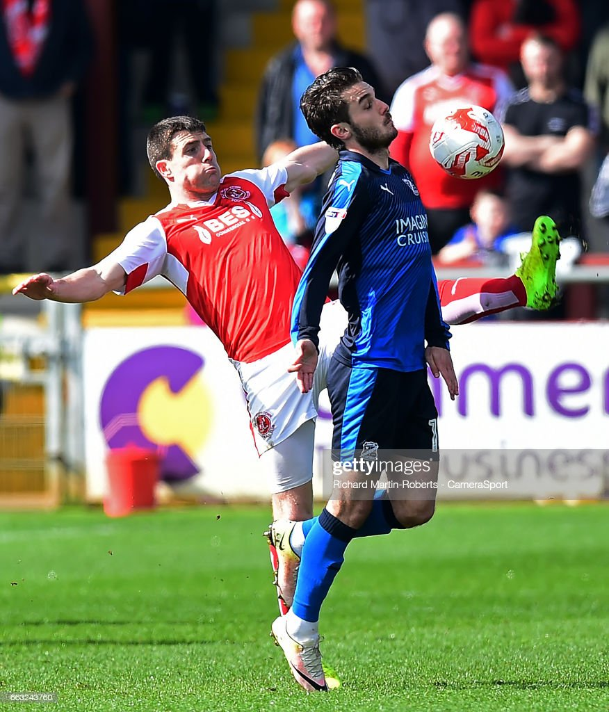 Swindon Town's John Goddard competes with Fleetwood Town's Bobby Grant during the Sky Bet League One match between Fleetwood Town and Swindon Town at Highbury Stadium on April 1, 2017 in Fleetwood, England.