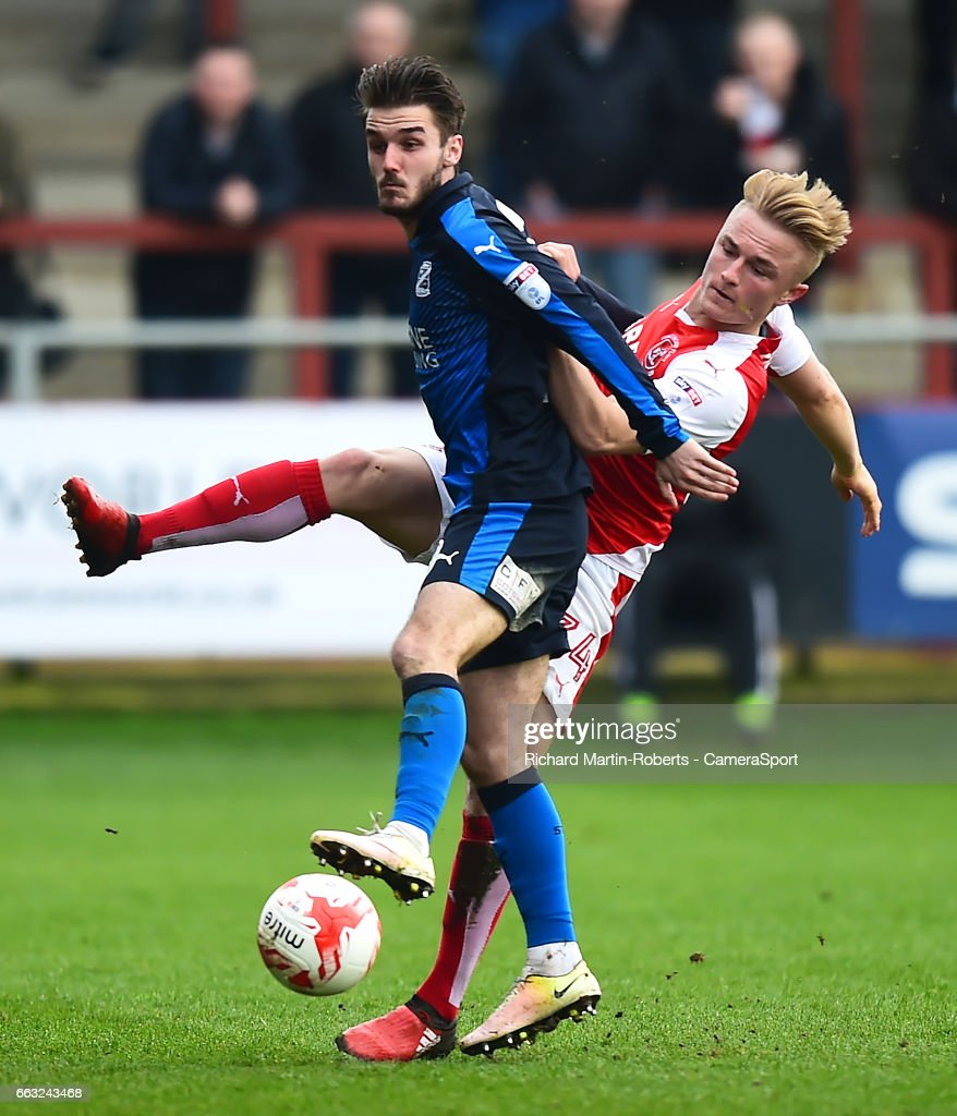 Swindon Town's John Goddard tangles with Fleetwood Town's Kyle Dempsey during the Sky Bet League One match between Fleetwood Town and Swindon Town at Highbury Stadium on April 1, 2017 in Fleetwood, England.