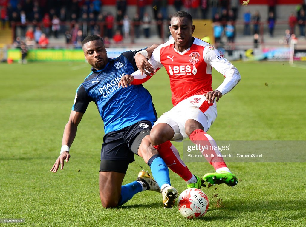 Swindon Town's Jonathan Obika challenges Fleetwood Town's Amari'i Bell during the Sky Bet League One match between Fleetwood Town and Swindon Town at Highbury Stadium on April 1, 2017 in Fleetwood, England.