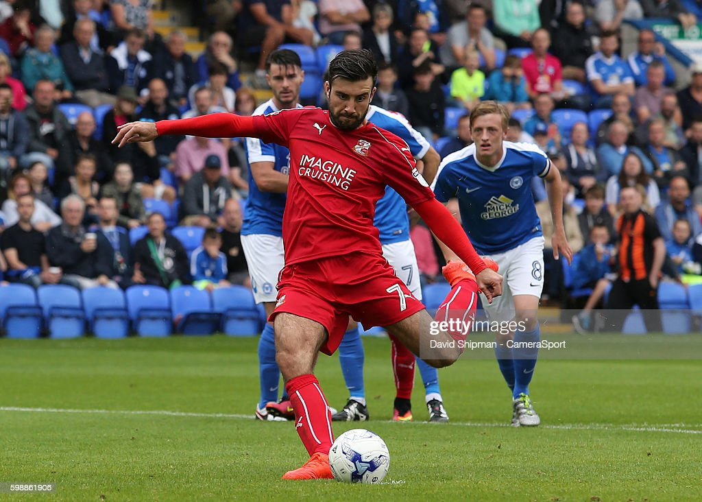 Swindon Town's Michael Doughty scores his sides first goal from the penalty spot (1-1) during the Sky Bet League One match between Peterborough United and Swindon Town at ABAX Stadium on September 3, 2016 in Peterborough, England.