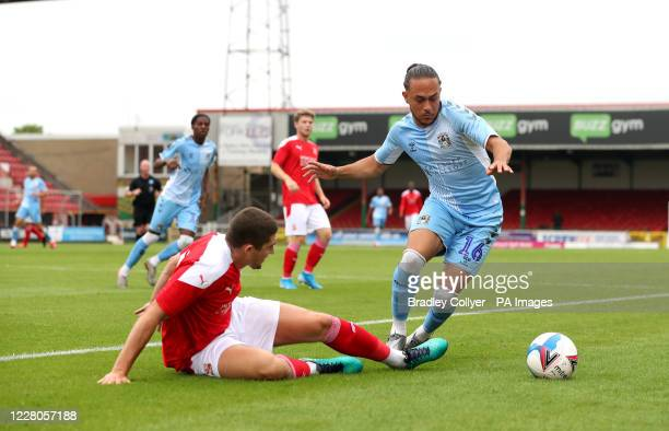 Swindon Town's Taylor Curran and Coventry City's Jodi Jones battle for the ball during the pre-season friendly match at The County Ground, Swindon.