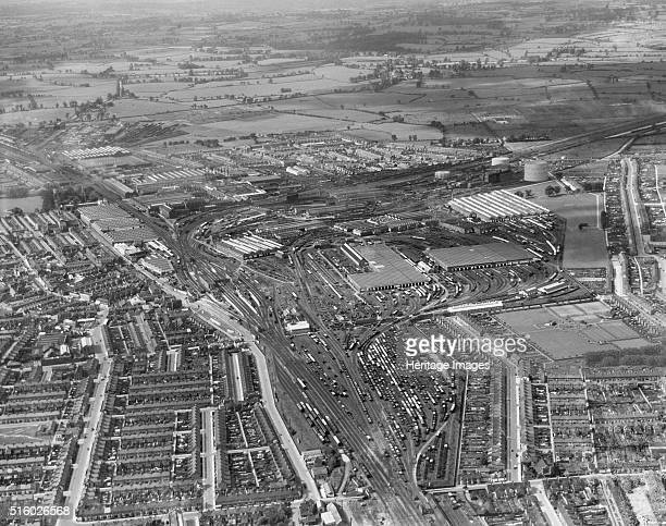 Swindon Wiltshire August 1938 Aerial view looking west showing the Great Western Railway Works Swindon Station and the workers' village Artist...