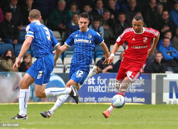 Swindon's John Bostock takes on Gillingham's Joe Martin and Andy Frampton during the League Two match at the MEMS Priestfield Stadium Gillingham