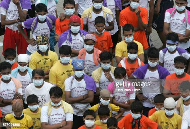Swine Flu in Mumbai Govinda wear masks to avoid swine flu virus and breaking the Dahi handi at 25 Lackhs Ghatkopar Ram Kadams Dahi Handi Mumbai