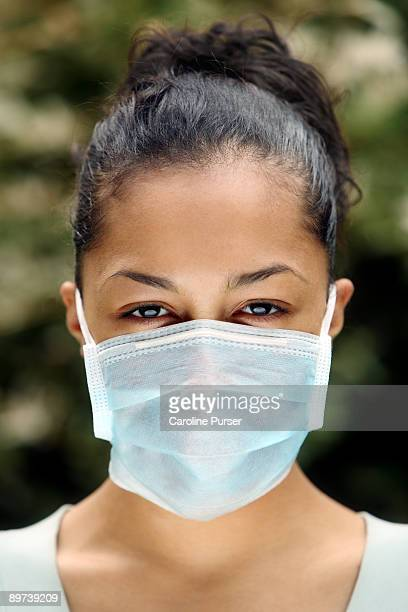 swine flu - flu mask stock photos and pictures