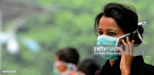 Swine flu suspect patient waiting outside the swine flu screening centre at the Ram Manohar Lohia hospital in New Delhi