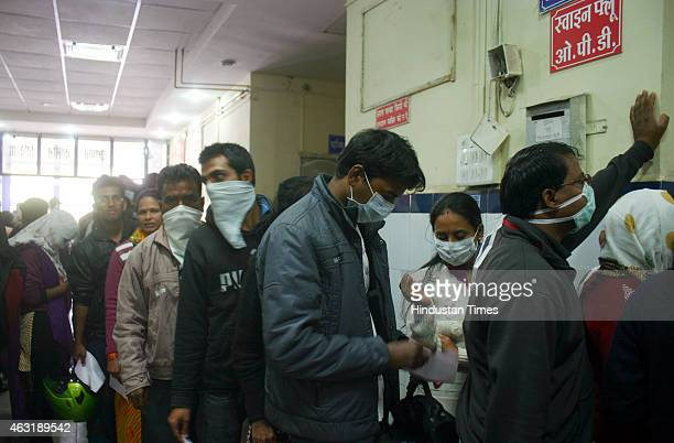 Swine flu suspect patients waiting for their turn outside swine flu screening centre at district hospital on February 11 2015 in Bhopal India As many...