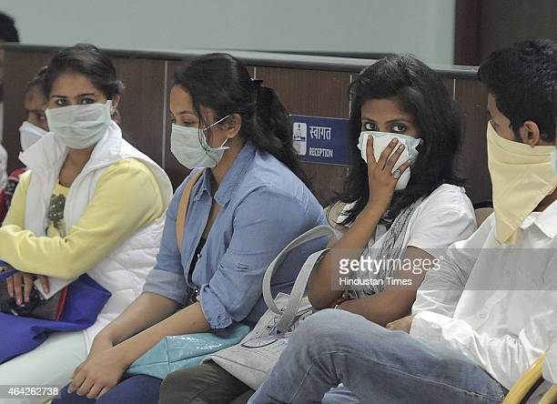 Swine flu suspect patients waiting for their turn outside swine flu screening ward at the Ram Manohar Lohia on February 23 2015 in New Delhi India...