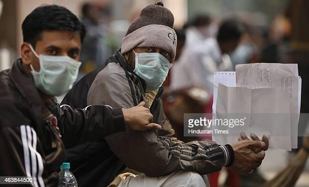 Swine flu suspect patients wearing masks waiting for their turn outside swine flu screening centre Swine Flu ward at the Ram Manohar Lohia Hospital...