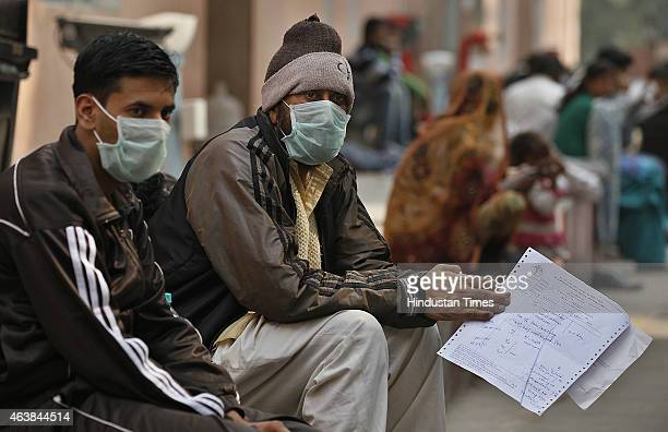 Swine flu suspect patients wearing masks waiting for their turn outside swine flu screening centre Swine Flu ward at the Ram Manohar Lohia Hospital...