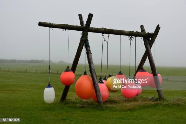 swing at farm of alftaver, in southern coast of iceland - rosenfarben stock-fotos und bilder