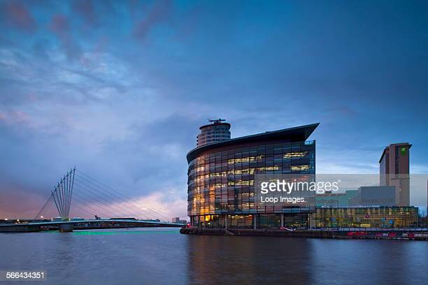 Swing bridge and Media City UK buildings located on the Salford Quays in the city of Salford near Manchester Old Trafford