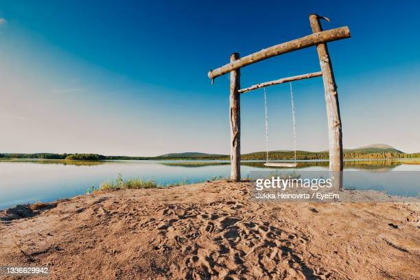 swing by the lake - heinovirta stock pictures, royalty-free photos & images